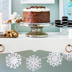 Arrange your dessert display on a white table adorned with a paper snowflake garland to create a sweet winter wonderland scene.