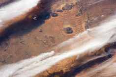 This photograph of cloud bands over southern Mauritania was taken from the International Space Station with an oblique angle such that the c...