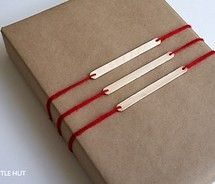 popsicle stick and yarn