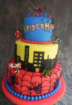 Tri-tier Spiderman theme cake with Thor Hulk Wolverine and Ironman figurines.JPG