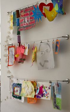Here's an idea for displaying children's work in the #Art Area of a #Creative_Curriculum for #Preschool classroom.
