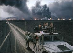 Photo © Bruno Barbey/Magnum Photos  KUWAIT. 1991. Burgan burning oil fields. U.S. Marines. The invasion of Kuwait by Iraq took place on August 2nd 1990. It was followed by the Allied intervention under operation Desert Storm. The Allies finally liberated Kuwait on February 27th 1991, after 7 months of occupation and 5 weeks of war.