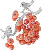 Van Cleef & Arpels Peau d'Âne collection white and pink gold Piou-Piou brooch with round and baguette diamonds, coral cabochons, spessartite garnets and multi-coloured sapphires.