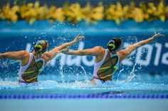 US swimmers Mary Killman and Mariya Koroleva compete in the duets free routine final during the synchronized swimming competition at the London 2012 Olympic Games on Aug. 7, 2012.