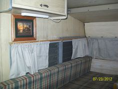 This is how it looks after the new curtains and picture.1969 Shasta travel trailer