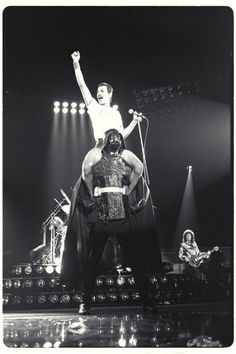 Freddie Mercury riding Darth Vader