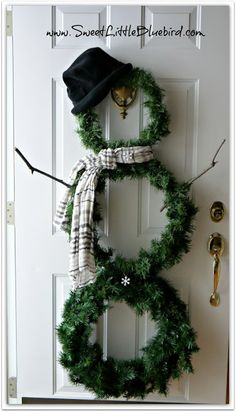 DIY Snowman Wreath! So simple to make! So fun! Just change the hat and scarf and keep him up all winter long! | SweetLittleBluebird.com