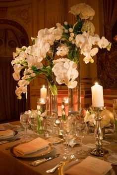 Tantawan Blooms - gorgeous!love the hold accents w orchids #stjohn # islandstyleweddings #elegantables
