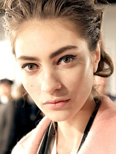 Look now: Black eyeliner—Makeup artist Gucci Westman gave models backstage at Rag & Bone fall 2014 detached floating wings