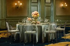 Clear chairs take on the look of glass when added to a table laden with crystal glassware at The Ritz-Carlton, Atlanta.