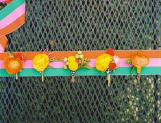citrus colored boutonnieres - photo by Ben Q - http://ruffledblog.com/color-pop-wedding-ideas/