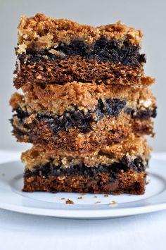 triple layer chocolate chip cookie-fudge brownie-peanut butter blondie bars .