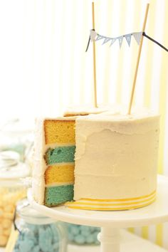 Gender Reveal theme... blue & yellow cake!  Would be so fun.