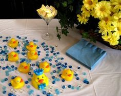 "Cheap and easy baby shower centerpiece idea!  Blue stones for ""water"""