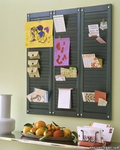 love the note book  with the pencil hanging the shutters but am totally head over heels with that clever letter sorter! Do you see that? It's coat hooks attached to a board!