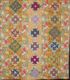 """'Growing Up With Grandma Toot, 72"""" x 84"""", by Trudy Davis; quilted by Denise Green, striped churn dash blocks surrounded by floral panels 2012 lake, denis green, churn dash, quilter guild, lake view"""