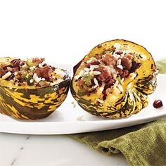 Sausage and Rice-Stuffed Acorn Squash Recipe. I'm pinning this more for the technique of roasting squash whole. According to CL, it locks in more flavor and makes it easier to cut. I'll try it!