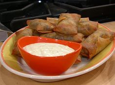 Cheesesteak Egg Rolls with Provolone Cheese Sauce.