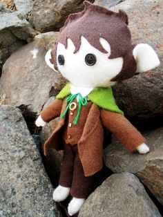 It's Frodo made of felt, complete with the one ring!