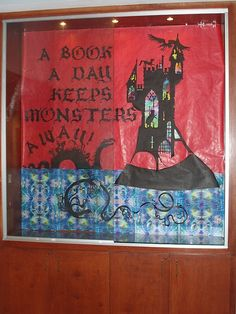 """A Book a Day Keeps the Monsters Away"" library bulletin board"