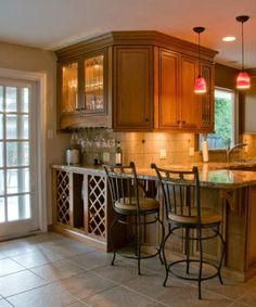 Love the wine rack under the breakfast bar ... We could totally do this!