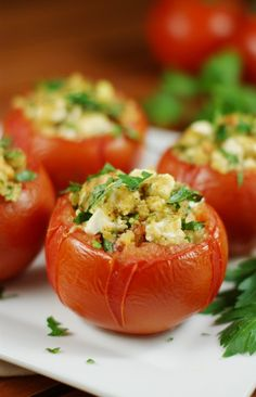 Feta-Stuffed Tomatoes ~ baked up with a flavorful feta cheese filling, these are a wonderful way to enjoy all those garden-fresh tomatoes!  www.thekitchenismyplayground.com #tomato