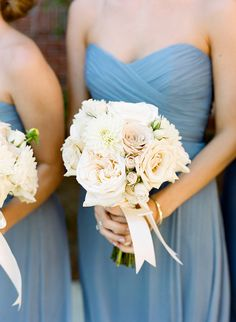 Blush and white bridesmaid bouquet with roses and dahlias | Melissa Schollaert Photography | Brides.com