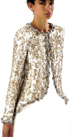 CHANEL~ Fall 2014~ gorgeous 18th century inspiration in this lavishly embroidered long jacket ~ gold thread embroidery on ivory.