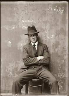 Vintage mug shot of a particularly handsome gangster