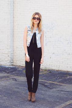 black jumpsuit & denim vest