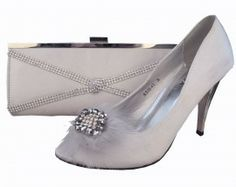 Ladies Evening Shoes, Silver Evening Shoes, Peep Toe Shoes. Silver satin evening shoes with a 9cm silver metallic heel.  Peep toe shoe with a diamante encrusted brooch surrounded by pewter silver beads and silver grey feathers for that extra added glamour.  A matching clutch bag is also available style code NAD253  These beautiful peep toe shoes will bring out a woman's true personality.