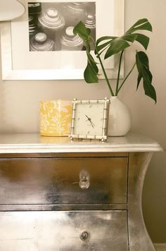 aluminum leaf on a cheap chest for a nightstand. Doing this for my side table. I plan to get a similarly shaped table (maybe a set) and just have it dark wood on Scott's side.