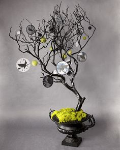 Spray a large branch black and decorate with Halloween Ornaments