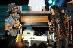 Johnny Depp photographed with Steven Tyler while accepting the Generation Award at the 2012 MTV Movie Awards in Los Angeles.