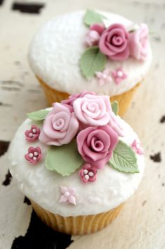 Resplendently beautiful pink and green rose topped cupcakes. #cupcake #food #baking #cake #dessert #flowers #shabby #chic #wedding #pink #rose #green