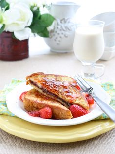 Nutella Stuffed French Toast with Maple Strawberry Syrup.