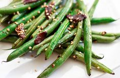 Asian green beans with sesame and garlic recipe   I have to try this!!! It's one of the few foods my daughter will eat at a Chinese buffet!!