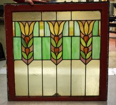 "Prairie style stained glass window; 'Tulips' 30 1/8""w x 29 1/2""h(incl. frame)  Price: $650.00"