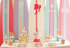 Surf boards make the perfect backdrop for this dessert table. #birthday #party #dessert #table