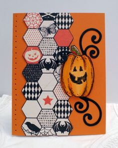 handmade Halloween card from Sleepy in Seattle ... fun look with smiling pumpkin focal point ... column of three hexagon stripss  ... each with Halloween colors and motifs .. orange base with piercing ... like it! ... Stampin' Up!