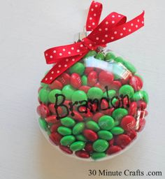 This Sweet and Simple Candy Ornament is a neat craft that will spread some holiday cheer and satisfy your kids' sweet tooth. Your little ones can pass out these homemade Christmas ornaments for kids and light up everyone's day.   AllFreeKidsCrafts.com