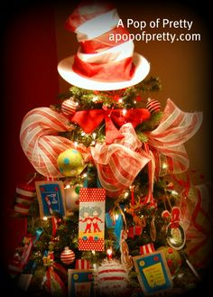 A fun and whimsical Dr. Seuss Christmas tree with mostly handmade decorations!  My favorite part? The Dr. Seuss Hat and Bow-Tie for the tree topper!