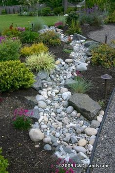 dry creek, front gardens, garden ideas, river rocks, side yards