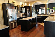 dark kitchen cabinets, dark wood floors  only slightly raised bar - pretty much my dream kitchen complete with the double oven