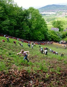 Copper's Hill Cheese-Rolling: A spirited gathering of people who chase a wheel of cheese down a 295-foot hill in the English countryside. How can that not be entertaining?