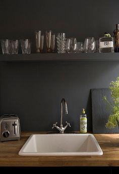 black kitchen, wood counters