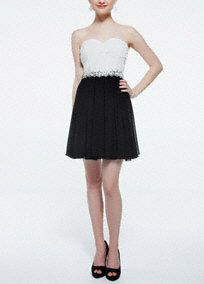 Stylish and ultra-chic, this strapless color block homecoming dress is a true winner!  Strapless sweetheart bodice with twist front detail creates a stunning focal point.  Empire waist with sparkling sequin detail shapes a beautiful silhouette.  Short black skirt adds movement and contrast.  Fully lined. Back zip. Imported polyester. Professional spot clean.
