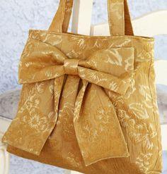 Becky: Pleated Bow Handbag with Double Handles  http://img2.etsystatic.com/000/0/5501127/il_fullxfull.343674794.jpg http://4.bp.blogspot.com/-EsI9DlrnYPs/TdDa155lAJI/AAAAAAAABkc/pCLqwc64_pk/s1600/%2528via+Light+Golden+Mini+Bag+w+Adjustable+by+peacelovenpolkadots+on+Etsy%2529.jpg