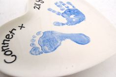Baby child footprints and handprints DIY handpainted on bisque pottery.  This is our own-brand heart pottery plate.  We have used Duncan EZ One Stroke Underglaze (as this really shows the lifelines in the prints) and for the writing we used Duncan French Dimensional underglaze.