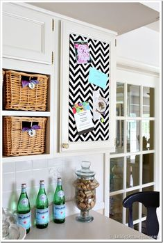 Use of a cabinet door.  (Also small use of a pattern/chevron)  Inset Kitchen Cabinet Memo Board - 15 Colorful DIY Home Decor Projects
